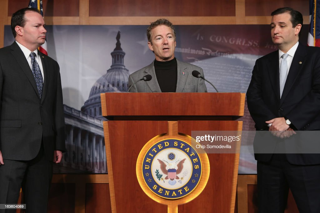 Sen. <a gi-track='captionPersonalityLinkClicked' href=/galleries/search?phrase=Rand+Paul&family=editorial&specificpeople=6939188 ng-click='$event.stopPropagation()'>Rand Paul</a> (R-KY) speaks during a news conference with Sen. Mike Lee (R-UT) (L) and Sen. <a gi-track='captionPersonalityLinkClicked' href=/galleries/search?phrase=Ted+Cruz&family=editorial&specificpeople=7222093 ng-click='$event.stopPropagation()'>Ted Cruz</a> (R-TX) to announce a plan to defund the Patient Protection and Affordable Care Act, also known as Obamacare, at the U.S. Capitol March 13, 2013 in Washington, DC. Although the conservative senators sponsoring the legislation expect it to fail, they believe it is an important survey of who supports health care reform.