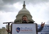 Sen Rand Paul speaks to supporters during a Tea Party rally in front of the US Capitol June 17 2013 in Washington DC The group Tea Party Patriots...