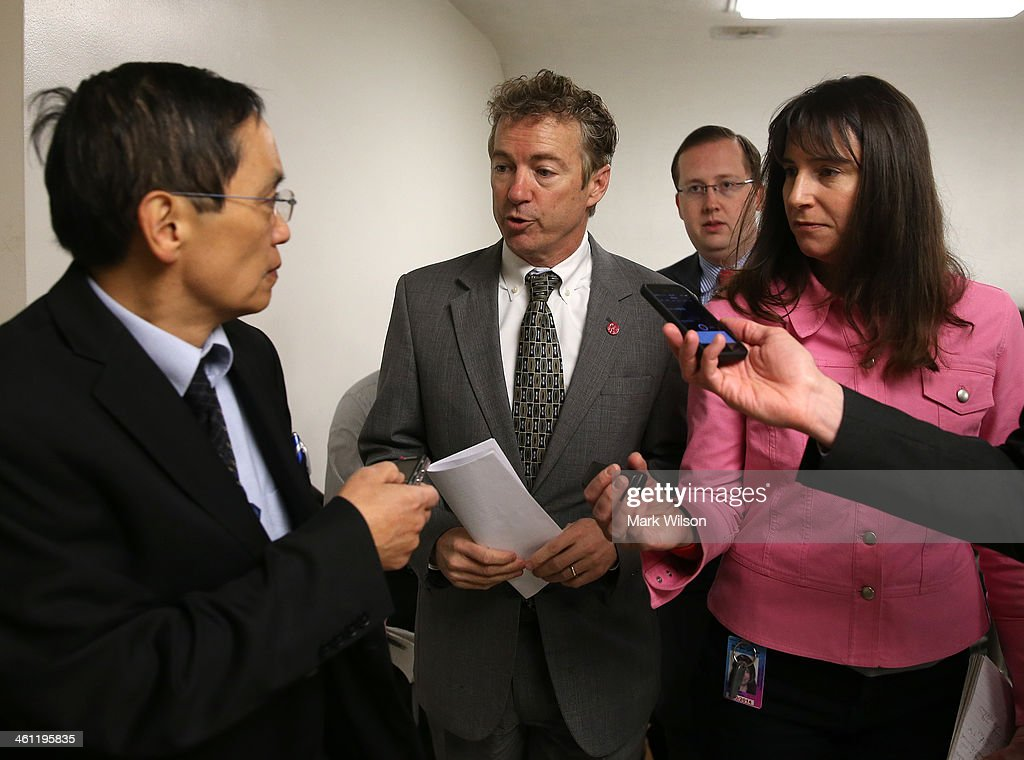 U.S. Sen. <a gi-track='captionPersonalityLinkClicked' href=/galleries/search?phrase=Rand+Paul&family=editorial&specificpeople=6939188 ng-click='$event.stopPropagation()'>Rand Paul</a> (R-KY) (2nd L) talks to reporters while walking to the Senate chamber to vote on unemployment insurance at the US Capitol January 7, 2014 in Washington, DC. The U.S. Senate voted 60-37 to move forward with a bill to extend federal unemployment benefits for three months.