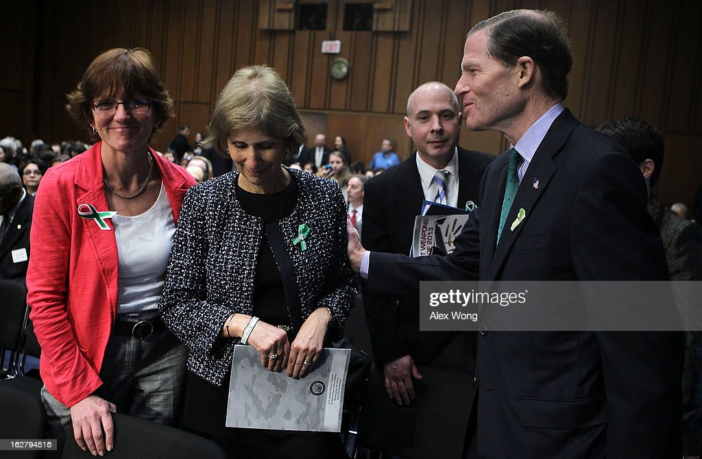 U.S. Sen. Richard Blumenthal (D-CT) (R) greets Newtown, Connecticut, middle school teachers Mary Connolly (L) and Lil Martenson (2nd L) prior to hearing before the Senate Judiciary Committee February 27, 2013 on Capitol Hill in Washington, DC. The committee held a hearing on 'The Assault Weapons Ban of 2013.'