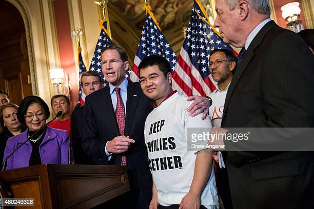 Sen Richard Blumenthal puts his hand around Raul Esparza United Farm Worker member as Sen Dick Durbin looks on during a news conference to discuss US...