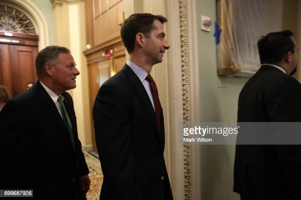 Sen Richard Burr and Sen Tom Cotton walk to a meeting where Republican members of the senate were expected to discuss their proposed health care bill...