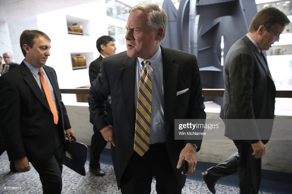 Sen. Richard Burr (C) (R-NC), chairman of the Senate Select Committee on Intelligence, and Sen. Mark Warner (R) (D-VA), ranking member of the committee, depart a closed committee meeting July 11, 2017 in Washington, DC. Before the meeting, Warner commented briefly on recent reports of Donald Trump Jr. meeting with a Russian lawyer in June 2016.