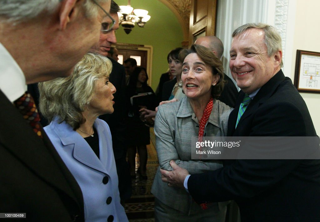 Sen. Richard Durbin (D-IL) (R) hugs Sen. Blanche Lincoln (D-AR) (2R) as Sen. Barbara Boxer (D-CA) (2L) and Senate Majority Leader Harry Reid (D-NV) stand nearby after voting to pass Wall Street reform, on May 20, 2010 in Washington, DC. In a 59-39 vote the Senate passed the landmark Wall Street regularly reform bill that will increase restrictions on the banking industry.