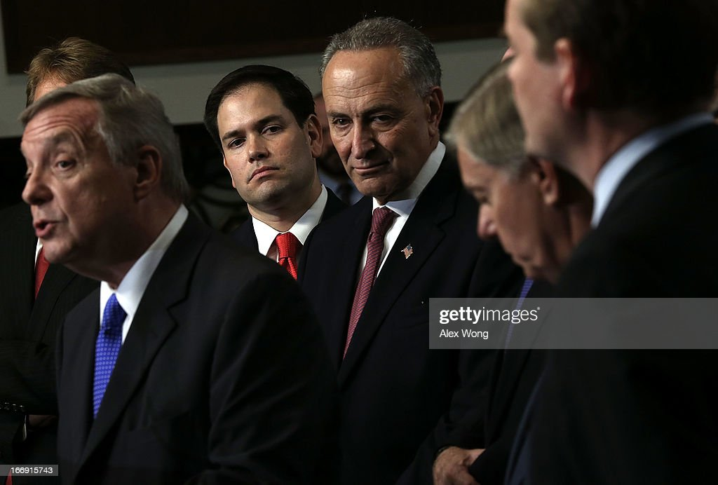 U.S. Sen. Richard Durbin (D-IL) speaks as Sen. Marco Rubio (R-FL), Sen. Charles Schumer (D-NY), Sen. Lindsey Graham (R-SC), and Sen. Michael Bennet (D-CO) listen during a news conference on immigration reform April 18, 2013 on Capitol Hill in Washington, DC. The senators discussed on the 'Border Security, Economic Opportunity, and Immigration Modernization Act' that have been released on Wednesday.