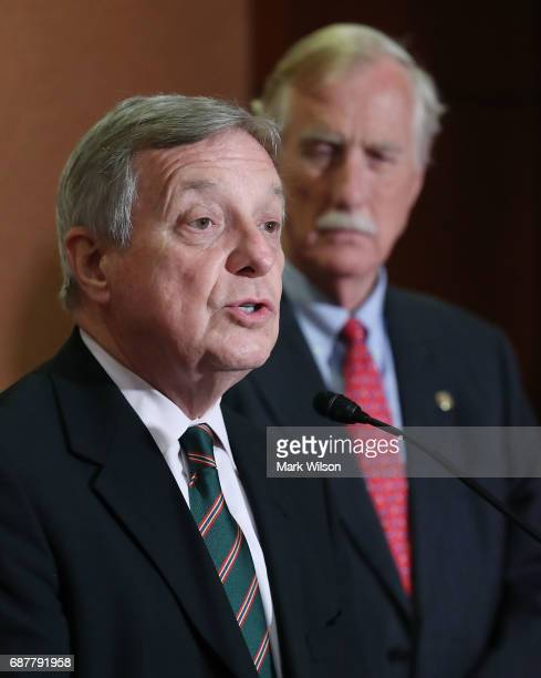 Sen Richard Durbin speaks while flanked by Sen Angus King during a news conference to discuss preexisting conditions clauses In US President Donald...