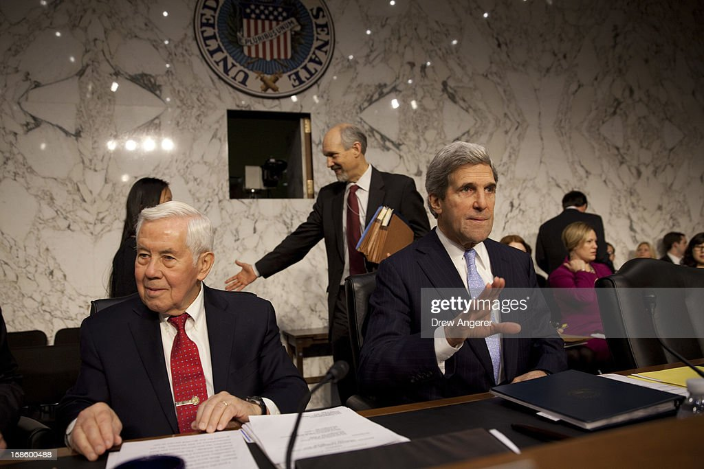 Sen. Richard Lugar (R-IN) (L) and Committee Chairman Sen. John Kerry (D-MA) prepare to give their opening remarks during the Senate Foreign Relations Committee hearing on the September 11th attacks on the U.S. Consulate in Benghazi, on Capitol Hill, December 20, 2012 in Washington, DC. Secretary of State Hillary Clinton had planned to testify at the hearing, but could not attend due to an illness.