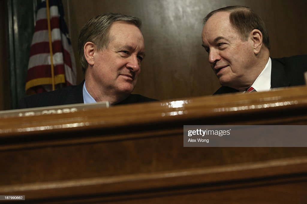 U.S. Sen. <a gi-track='captionPersonalityLinkClicked' href=/galleries/search?phrase=Richard+Shelby&family=editorial&specificpeople=529578 ng-click='$event.stopPropagation()'>Richard Shelby</a> (R-AL) (R) talks to committee ranking member Sen. Mike Crapo (R-ID) (L) during a confirmation hearing for Nominee for the Federal Reserve Board Chairman Janet Yellen (3rd L) before Senate Banking, Housing and Urban Affairs Committee November 14, 2013 on Capitol Hill in Washington, DC. Yellen will be the first woman to head the Federal Reserve if confirmed by the Senate and will succeed Ben Bernanke.