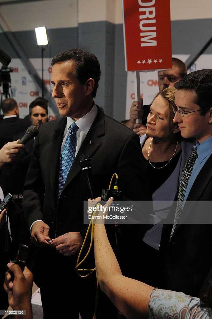 U.S. Sen. Rick Santorum speaks in the spin room with his wife Karen and son Daniel following the Republican presidential primary debate June 13, 2011 at Saint Anselm College in Manchester, New Hampshire. Tonight's debate was the first for the 2012 GOP contenders in the 'First in the Nation' primary state of New Hampshire.