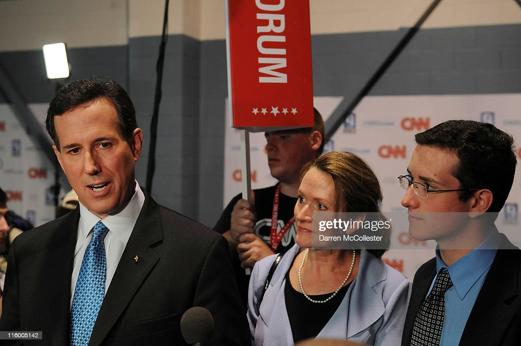 U.S. Sen. <a gi-track='captionPersonalityLinkClicked' href=/galleries/search?phrase=Rick+Santorum&family=editorial&specificpeople=212911 ng-click='$event.stopPropagation()'>Rick Santorum</a> speaks in the spin room with his wife Karen and son Daniel following the Republican presidential primary debate June 13, 2011 at Saint Anselm College in Manchester, New Hampshire. Tonight's debate was the first for the 2012 GOP contenders in the 'First in the Nation' primary state of New Hampshire.