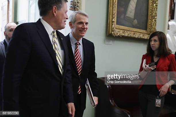 Sen Rob Portman and Sen Steve Daines leave the weekly Senate Republican policy luncheon in the US Capitol May 17 2016 in Washington DC Despite having...