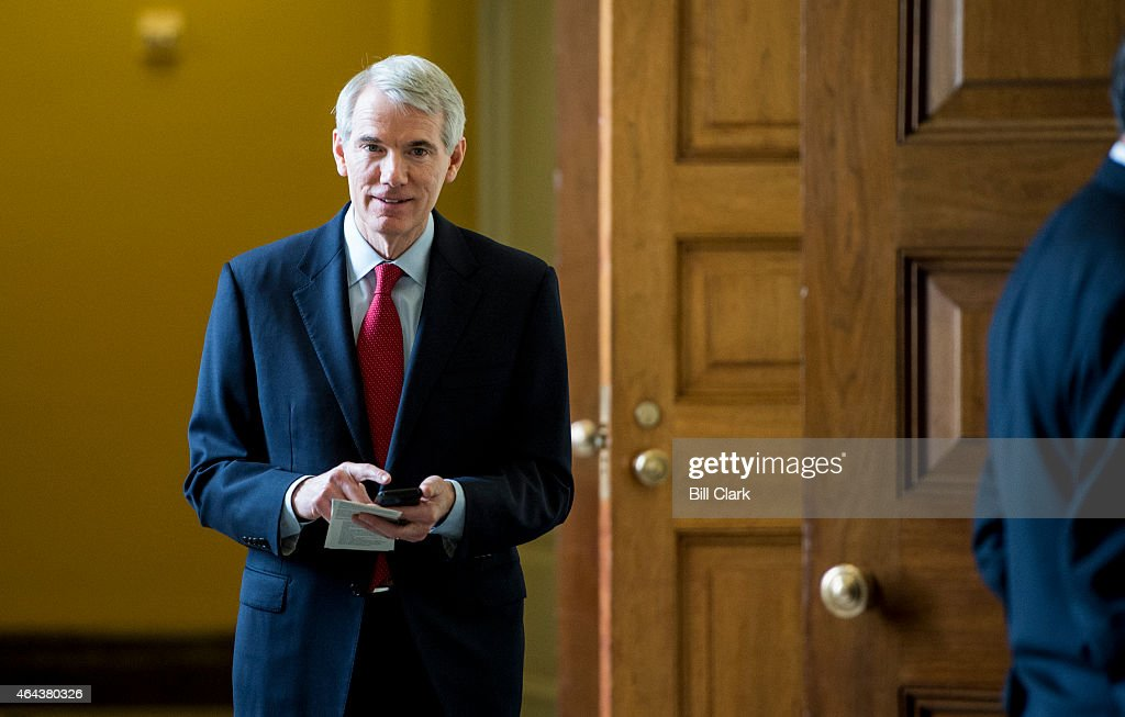 Sen. <a gi-track='captionPersonalityLinkClicked' href=/galleries/search?phrase=Rob+Portman&family=editorial&specificpeople=226973 ng-click='$event.stopPropagation()'>Rob Portman</a>, R-Ohio, arrives for the Senate Republicans' lunch in the Capitol on Wednesday, Feb. 25, 2015.