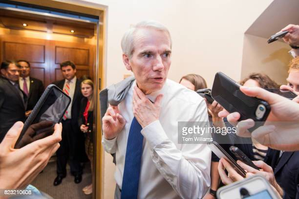 Sen Rob Portman ROhio talks with reporters in the senate subway before a series of votes in the Capitol related to the healthcare plan on July 26 2017