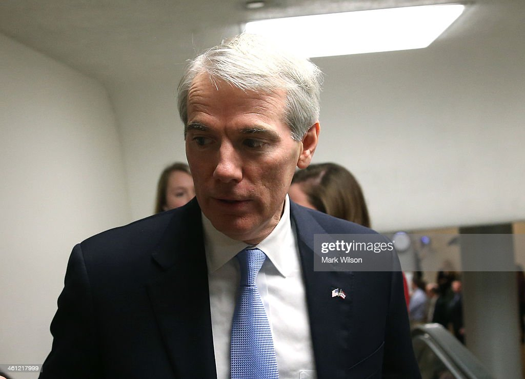 U.S. Sen. <a gi-track='captionPersonalityLinkClicked' href=/galleries/search?phrase=Rob+Portman&family=editorial&specificpeople=226973 ng-click='$event.stopPropagation()'>Rob Portman</a> (R-OH) walks to the Senate chamber for the cloture vote on unemployment insurance, at the US Capitol, January 7, 2014 in Washington, DC. The US Senate voted 60-37 to move forward with a bill to extend federal unemployment benefits for three months.