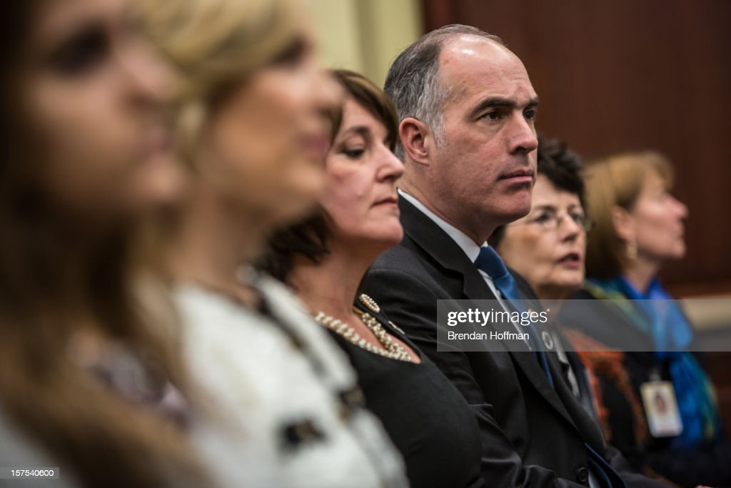 U.S. Sen. Robert Casey (D-PA) (4th L) and his wife Terese Casey (3rd L) listen during an event on Capitol Hill to raise awareness of the unfinished national memorial to the passengers and crew of Flight 93 on December 4, 2012 in Washington, DC. The plane was hijacked on September 11 but passengers and crew fought back, crashing the plane into a field in Shanksville, Pennsylvania.