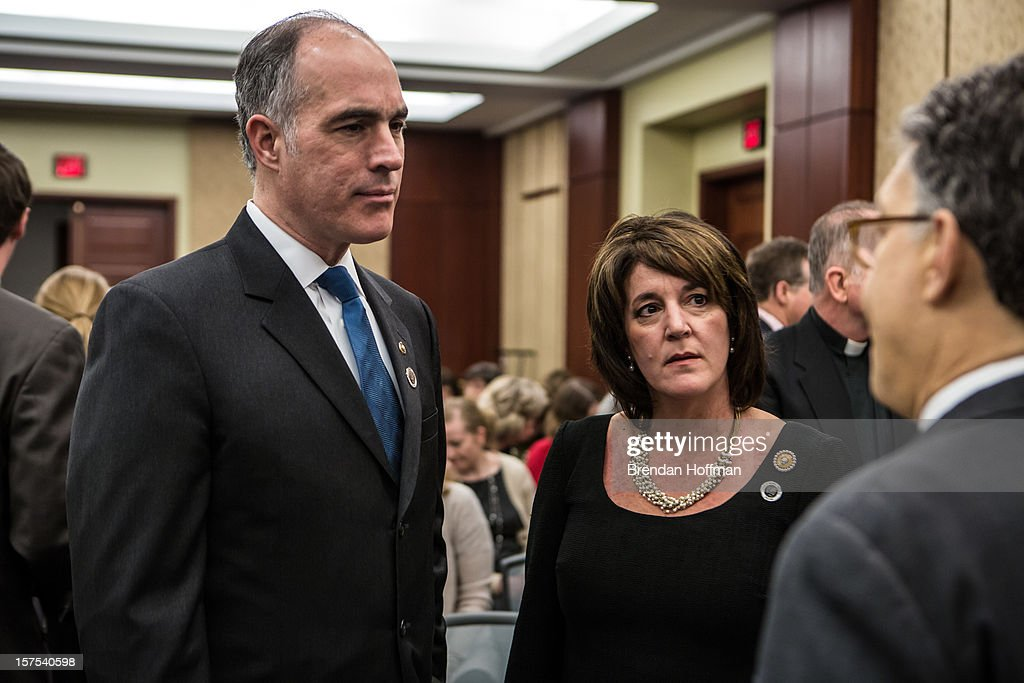 U.S. Sen. Robert Casey (D-PA) (L) and his wife Terese Casey (C) talk with U.S. Sen. Al Franken (D-MN) at an event on Capitol Hill to raise awareness of the unfinished national memorial to the passengers and crew of Flight 93 on December 4, 2012 in Washington, DC. The plane was hijacked on September 11 but passengers and crew fought back, crashing the plane into a field in Shanksville, Pennsylvania.