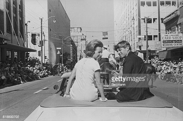 Sen Robert F Kennedy and wife Ethel ride atop backseat of convertible in Calgary Stampede They received a warm reception from a crowd of 400000 that...