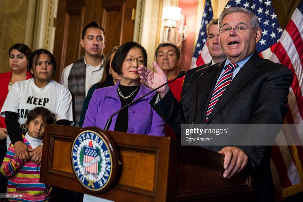 Sen. Robert Menendez (D-NJ), flanked by Sen. Mazie Hirono (D-HI) and immigration activists and supporters, speaks during a news conference to discuss U.S. President Barack Obama's executive order on immigration, on Capitol Hill, December 10, 2014 in Washington, DC. President Obama traveled to Nashville, Tennessee on Tuesday, where he defended his actions on immigration and again called on Congress to pass an immigration bill.