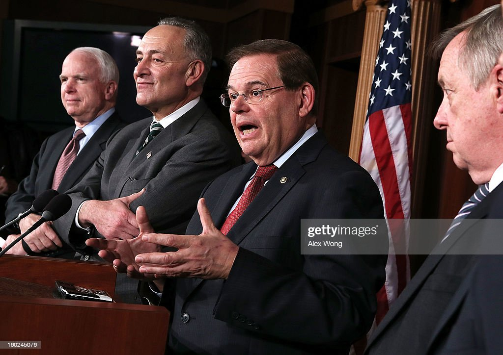 U.S. Sen. <a gi-track='captionPersonalityLinkClicked' href=/galleries/search?phrase=Robert+Menendez&family=editorial&specificpeople=504931 ng-click='$event.stopPropagation()'>Robert Menendez</a> (D-NJ) (3rd L) speaks as (L-R) Sen. <a gi-track='captionPersonalityLinkClicked' href=/galleries/search?phrase=John+McCain&family=editorial&specificpeople=125177 ng-click='$event.stopPropagation()'>John McCain</a> (R-AZ), Sen. <a gi-track='captionPersonalityLinkClicked' href=/galleries/search?phrase=Charles+Schumer&family=editorial&specificpeople=171249 ng-click='$event.stopPropagation()'>Charles Schumer</a> (D-NY), and Senate Majority Whip Sen. Richard Durbin (D-IL) listen during a news conference on a comprehensive immigration reform framework January 28, 2013 on Capitol Hill in Washington, DC. A group of bipartisan senate members have reached to a deal of outlines to reform the national immigration laws that will provide a pathway for the 11 million illegal immigrants in the country to citizenship.