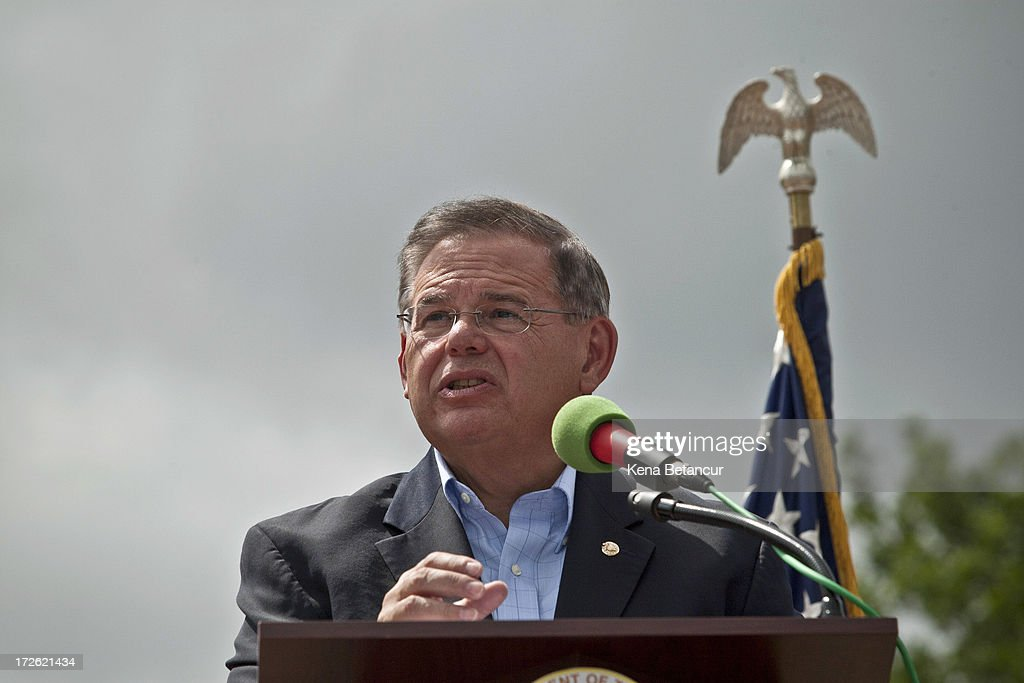 U.S. Sen. <a gi-track='captionPersonalityLinkClicked' href=/galleries/search?phrase=Robert+Menendez&family=editorial&specificpeople=504931 ng-click='$event.stopPropagation()'>Robert Menendez</a> (D-NJ) speaks at the reopening ceremony of the Statue of Liberty on the first day it is open to the public after Hurricane Sandy on July 4, 2013 on the Liberty Island in New York City. The statue was mostly spared by the storm, but the surrounding infrastructure was badly damaged.