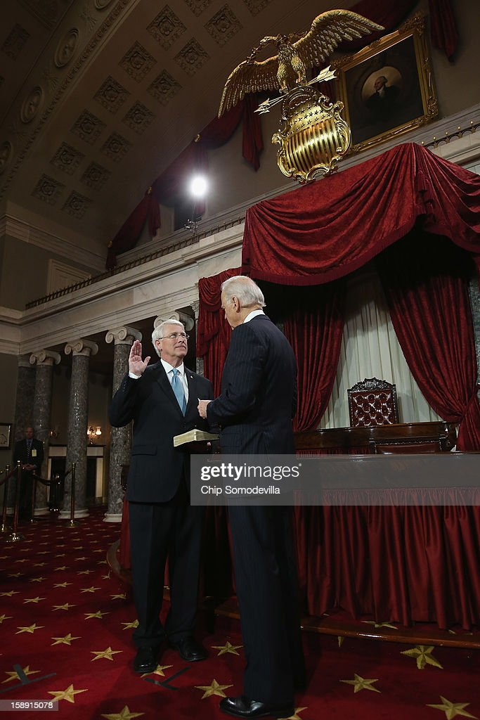 U.S. Sen. Roger Wicker (R-MS) (L) participates in a reenacted swearing-in with U.S. Vice President Joe Biden in the Old Senate Chamber at the U.S. Capitol January 3, 2013 in Washington, DC. Biden swore in the newly-elected and re-elected senators earlier in the day on the floor of the current Senate chamber.