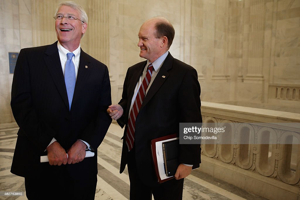 Sen. <a gi-track='captionPersonalityLinkClicked' href=/galleries/search?phrase=Roger+Wicker&family=editorial&specificpeople=1194753 ng-click='$event.stopPropagation()'>Roger Wicker</a> (R-MS) and Sen. Chris Coons (D-DE) visit after a Senate bipartisan lunch in the Russell Senate Office Building on Capitol Hill February 4, 2015 in Washington, DC. Senators from both parties said they did not talk about current legislation during the lunch and said they plan to continue the bipartisan lunch once every month.