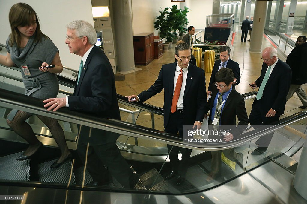 Sen. Roger Wicker (R-MS) (2nd L), Sen. John Thune (R-SD) (C) and Sen. Saxby Chambliss (R-GA) (R) head to the Senate chamber to vote against cloture on the confirmation of former Sen. Chuck Hagel (R-NE) to be the next Secretary of State at the U.S. Capitol February 14, 2013 in Washington, DC. Senators voted 58-40 against ending debate on the confirmation of Hagel, stalling his approval for another day or possibly a week.