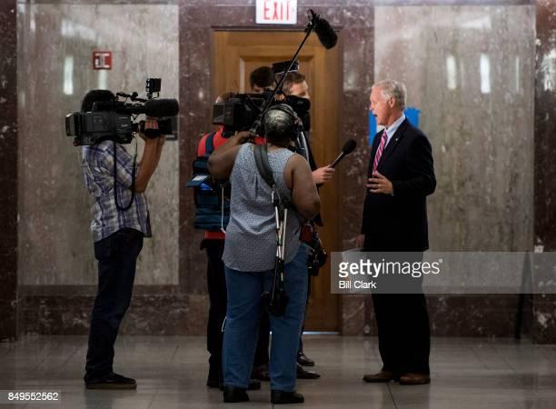 Sen Ron Johnson RWisc stops to speak to media as he walks through the Dirksen Senate Office Building on Tuesday Sept 19 2017