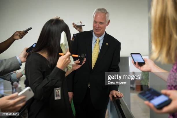 Sen Ron Johnson talks to reporters as he walks through the Senate subway on his way to an amendment vote on the GOP heath care legislation on Capitol...