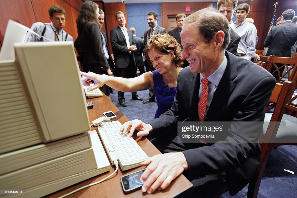 U.S. Sen. <a gi-track='captionPersonalityLinkClicked' href=/galleries/search?phrase=Ron+Wyden&family=editorial&specificpeople=233819 ng-click='$event.stopPropagation()'>Ron Wyden</a> (D-OR) (R) and his Communications Director Jennifer Holelzer play the computer game 'Oregon Trail' on an Apple IIGS after a news conference about the 25th anniversary of the Electronic Communications Privacy Act (ECPA) October 18, 2011 in Washington, DC. Wyden and U.S. Sen. Mark Kirk (R-IL) called for the ECPA legislation to be updated so to ensure that the government must get a warrant from a judge before tracking our movements or reading our private communications.