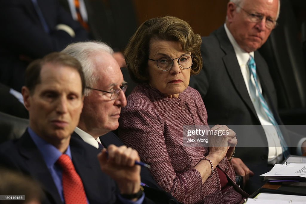 U.S. Sen. Ron Wyden (D-OR), Sen. John Rockefeller (D-WV), committee chairman Sen. Dianne Feinstein (D-CA), and ranking member Sen. Saxby Chambliss (R-GA) listen during a hearing before the Senate (Select) Intelligence Committee June 5, 2014 on Capitol Hill in Washington, DC. The hearing was focused on 'Foreign Intelligence Surveillance Act (FISA) Reforms' and H.R.3361 the 'USA FREEDOM Act.'