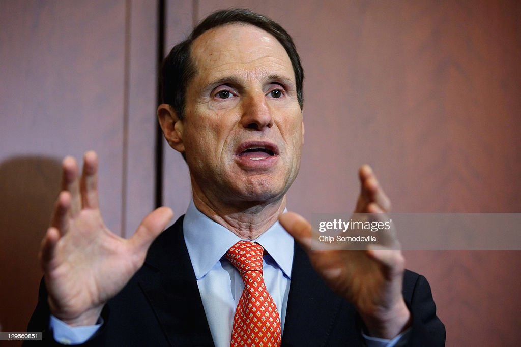 U.S. Sen. <a gi-track='captionPersonalityLinkClicked' href=/galleries/search?phrase=Ron+Wyden&family=editorial&specificpeople=233819 ng-click='$event.stopPropagation()'>Ron Wyden</a> (D-OR) (L) speaks during a news conference about the 25th anniversary of the Electronic Communications Privacy Act (ECPA) October 18, 2011 in Washington, DC. Wyden and U.S. Sen. Mark Kirk (R-IL) called for the ECPA legislation to be updated so to ensure that the government must get a warrant from a judge before tracking our movements or reading our private communications.