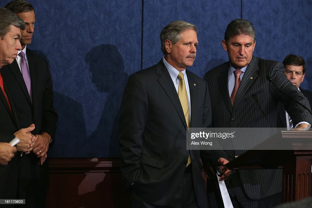 U.S. Sen. <a gi-track='captionPersonalityLinkClicked' href=/galleries/search?phrase=Roy+Blunt&family=editorial&specificpeople=233679 ng-click='$event.stopPropagation()'>Roy Blunt</a> (R-MO), Sen. <a gi-track='captionPersonalityLinkClicked' href=/galleries/search?phrase=John+Thune&family=editorial&specificpeople=534356 ng-click='$event.stopPropagation()'>John Thune</a> (R-SD), Sen. <a gi-track='captionPersonalityLinkClicked' href=/galleries/search?phrase=John+Hoeven&family=editorial&specificpeople=3082698 ng-click='$event.stopPropagation()'>John Hoeven</a> (R-ND), Sen. <a gi-track='captionPersonalityLinkClicked' href=/galleries/search?phrase=Joe+Manchin&family=editorial&specificpeople=568465 ng-click='$event.stopPropagation()'>Joe Manchin</a> (D-WV) and Sen. Mark Begich (D-AK) attend a news conference September 19, 2013 on Capitol Hill in Washington, DC. The news conference was to called on the Obama Administration approve the Keystone XL pipeline project.