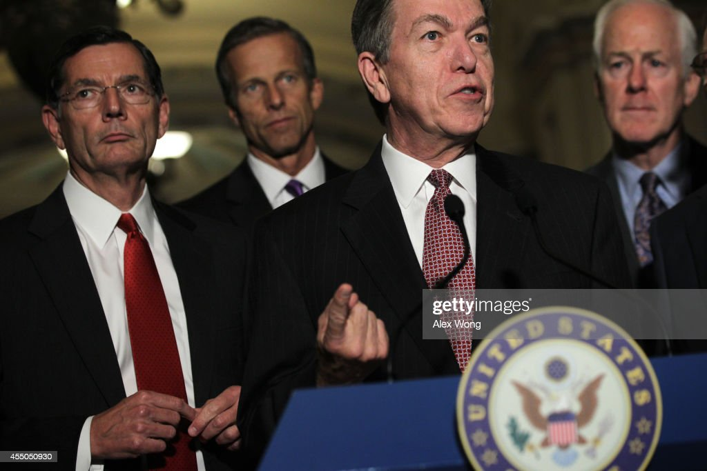 U.S. Sen. Roy Blunt (R-MO) (3rd L) speaks to members of the media as Sen. John Barrasso (R-WY) (L), Sen. John Thune (R-SD) (2nd L), and Senate Minority Whip Sen. John Cornyn (R-TX) listen after the Senate Republican weekly policy luncheon September 9, 2014 on Capitol Hill in Washington, DC. Senate Republicans held its week policy luncheon to discuss Republican agenda.