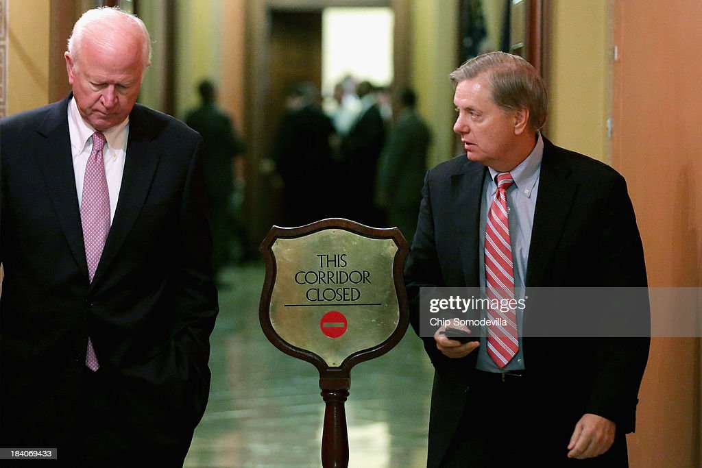 Sen. Saxby Chambliss (R-GA) (L) and Sen. Lindsey Graham (R-SC) leave a Senate Republican caucus meeting at the U.S. Capitol October 11, 2013 in Washington, DC. Senate Republicans met with President Barack Obama at the White House to discuss proposals to end the stalemate on the 11th day of the federal government partial shutdown.