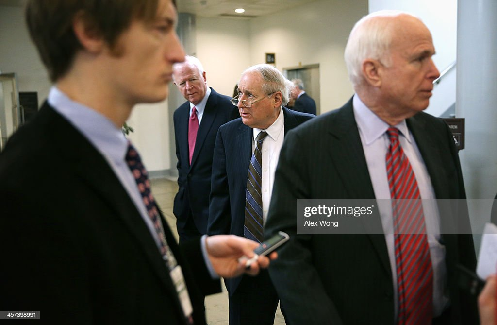 U.S. Sen. Saxby Chambliss (R-GA) (2nd L), Sen. Carl Levin (D-MI) (2nd R) and Sen. John McCain (R-AZ) (R) walk after a vote December 17, 2013 on Capitol Hill in Washington, DC. The Senate has passed a cloture vote to clear the way for a final vote of the Ryan-Murray Bipartisan Budget Act of 2013.