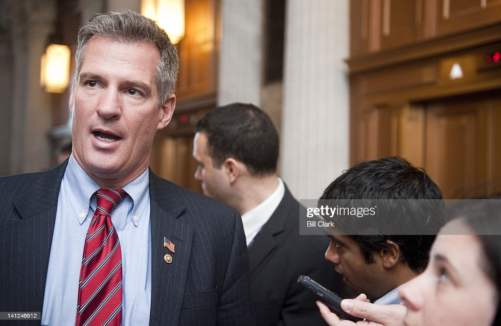 Sen. Scott Brown, R-Mass., speaks with reporters as he leaves the Senate Republicans' policy lunch on Tuesday, March 13, 2012.