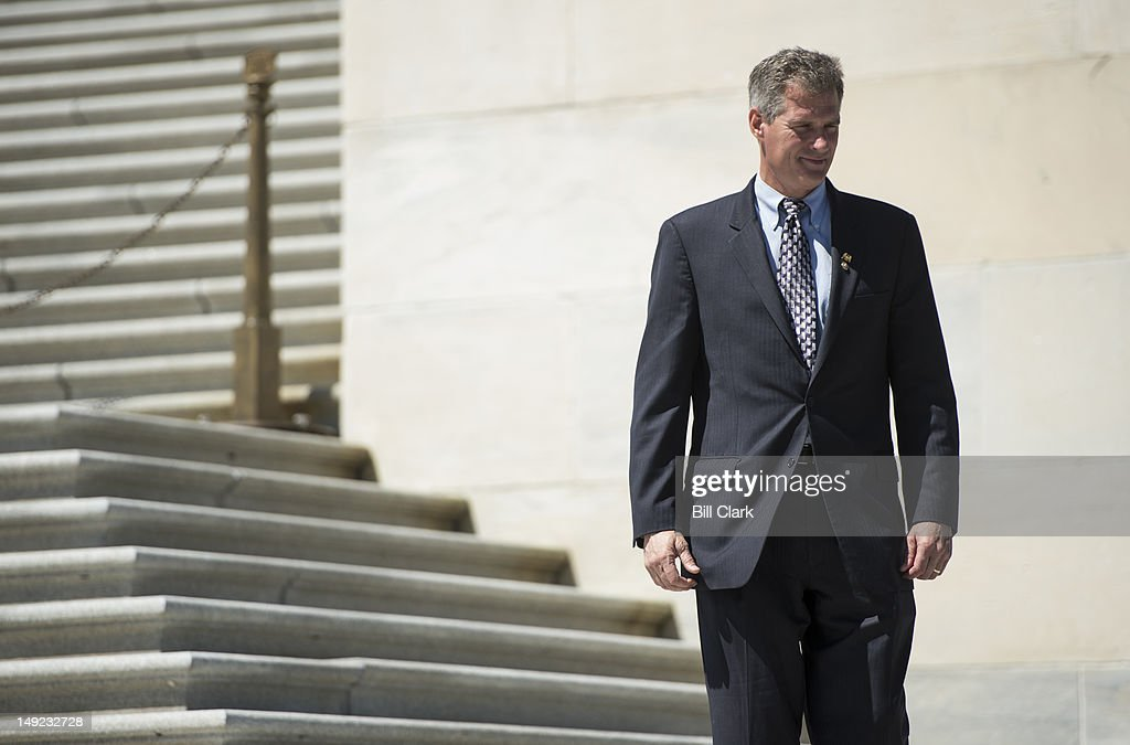 Sen. Scott Brown, R-Mass., waits to pose for photos on the Senate steps on Wednesday, July 25, 2012.