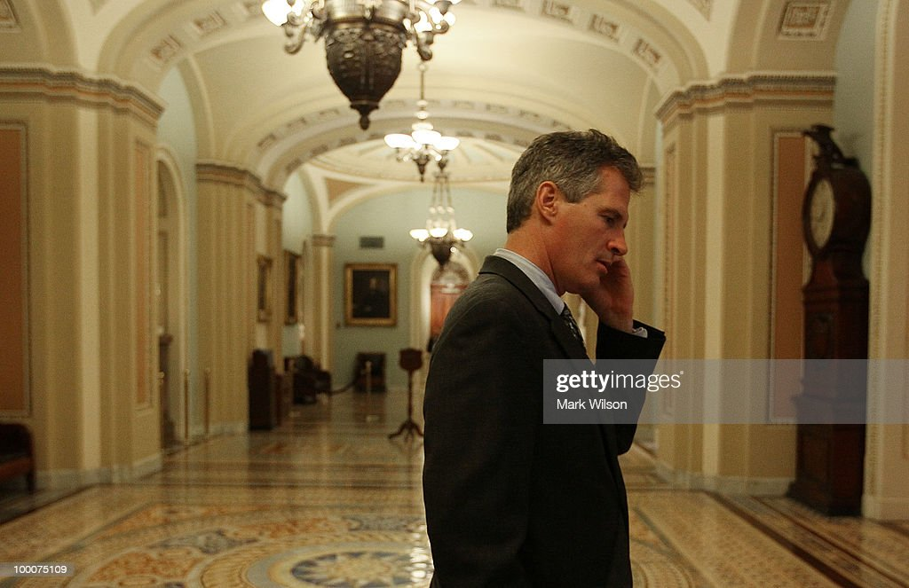 Sen. Scott Brown (R-MA) talks on his phone outside of the Senate chamber before voting on Wall Street reform, on May 20, 2010 in Washington, DC. The Senate is set to vote on final passage of a landmark Wall Street regularly reform bill that would increase restrictions on the banking industry.