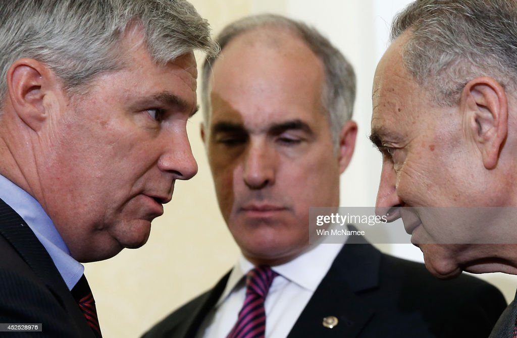 U.S. Sen. <a gi-track='captionPersonalityLinkClicked' href=/galleries/search?phrase=Sheldon+Whitehouse&family=editorial&specificpeople=599442 ng-click='$event.stopPropagation()'>Sheldon Whitehouse</a> (L) (D-RI) confers with U.S. Sen. <a gi-track='captionPersonalityLinkClicked' href=/galleries/search?phrase=Charles+Schumer&family=editorial&specificpeople=171249 ng-click='$event.stopPropagation()'>Charles Schumer</a> (R) (D-NY) as U.S. Sen. Robert Casey (D-PA) listens during a press conference about the 'Bring Jobs Home Act' at the U.S. Capitol July 22, 2014 in Washington, DC. The bill would create financial incentives for companies to return jobs to the U.S. that have been outsourced to other countries, and eliminate loopholes that financially benefit companies when they relocate jobs to other nations.