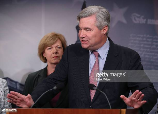 Sen Sheldon Whitehouse is flanked by Sen Jeanne Shaheen while speaking about the impact that repealing the Affordable Care Act would have on the...