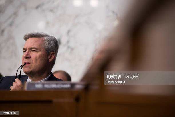 Sen Sheldon Whitehouse listens to testimony from William Browder chief executive officer of Hermitage Capital Management during a Senate Judiciary...