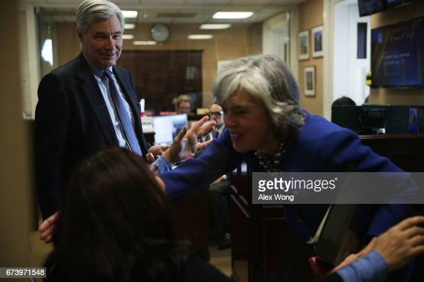 S Sen Sheldon Whitehouse looks on as Rep Katherine Clark greets Sen Tammy Duckworth prior to a news conference at the Capitol April 27 2017 in...