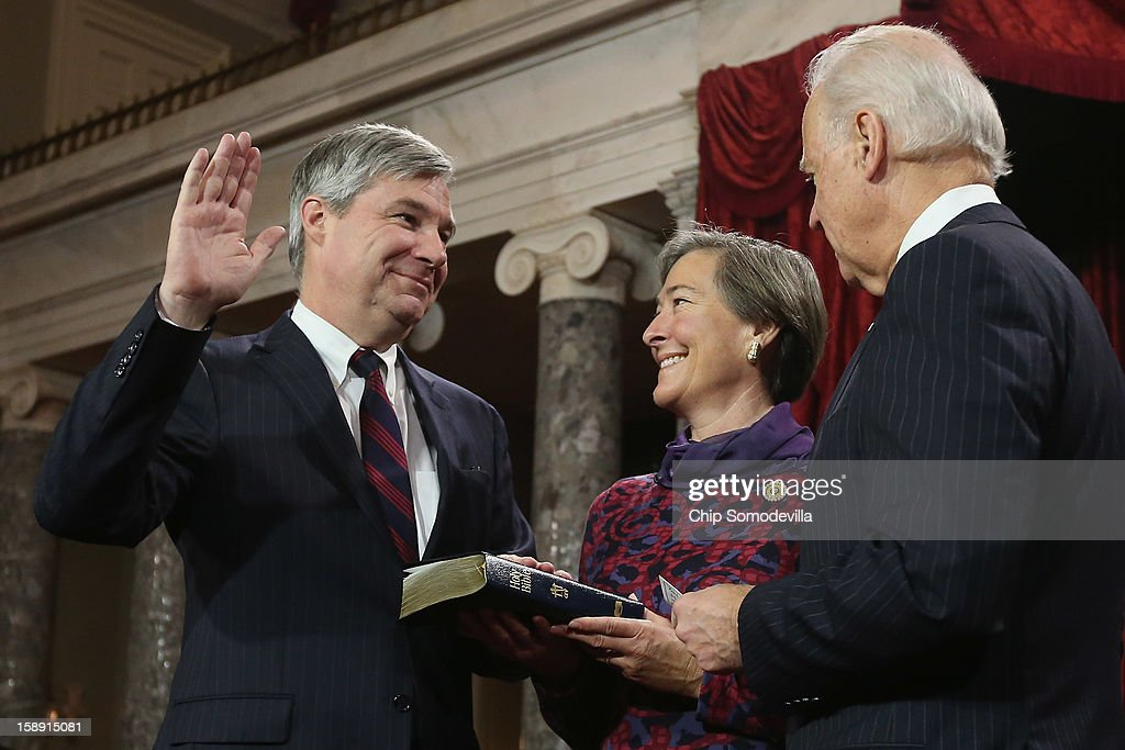 U.S. Sen. <a gi-track='captionPersonalityLinkClicked' href=/galleries/search?phrase=Sheldon+Whitehouse&family=editorial&specificpeople=599442 ng-click='$event.stopPropagation()'>Sheldon Whitehouse</a> (D-RI) (L) participates in a reenacted swearing-in with his wife Sandra Thornton Whitehouse and U.S. Vice President Joe Biden in the Old Senate Chamber at the U.S. Capitol January 3, 2013 in Washington, DC. Biden swore in the newly-elected and re-elected senators earlier in the day on the floor of the current Senate chamber.