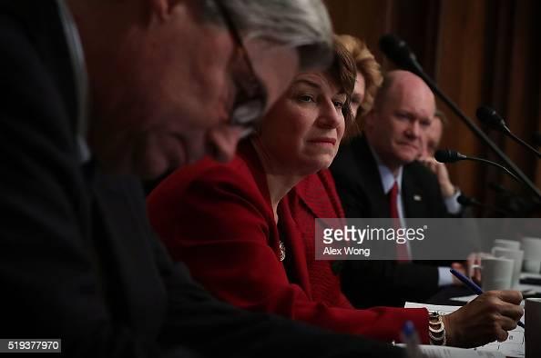 US Sen Sheldon Whitehouse Sen Amy Klobuchar and Sen Chris Coons listen during a Senate Democratic Steering and Outreach Committee forum April 6 2016...