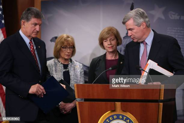Sen Sheldon Whitehouse Sen Jeanne Shaheen Sen Maggie Hassan and Sen Joe Manchin participate in a news conference about impact that repealing the...