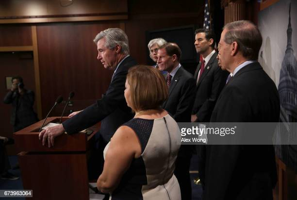 US Sen Sheldon Whitehouse speaks as Rep Katherine Clark Sen Richard Blumenthal and Rep John Sarbanes look on during a news conference at the Capitol...