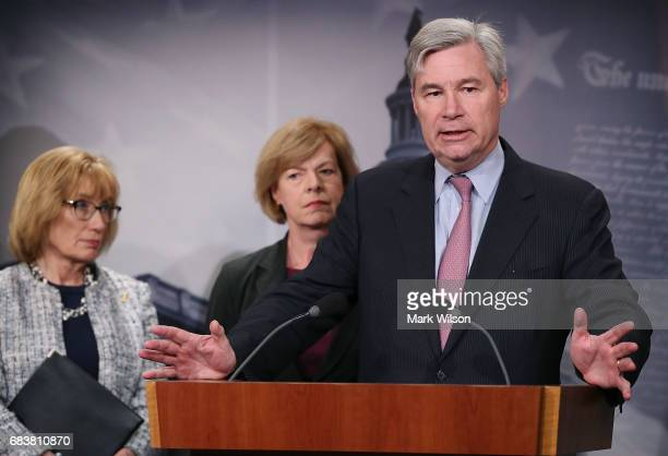 Sen Sheldon Whitehouse speaks while flanked by Sen Jeanne Shaheen Sen Maggie Hassan speaks about the impact that repealing the Affordable Care Act...