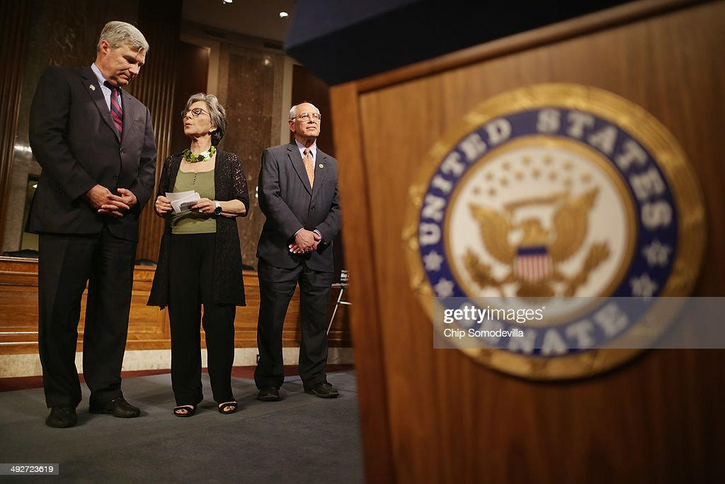 Sen. <a gi-track='captionPersonalityLinkClicked' href=/galleries/search?phrase=Sheldon+Whitehouse&family=editorial&specificpeople=599442 ng-click='$event.stopPropagation()'>Sheldon Whitehouse</a> (D-RI) (L) talks with Senate Environment and Public Works Chairwoman <a gi-track='captionPersonalityLinkClicked' href=/galleries/search?phrase=Barbara+Boxer&family=editorial&specificpeople=169888 ng-click='$event.stopPropagation()'>Barbara Boxer</a> (D-CA) with Rep. Paul Tonko (D-NY) during a 'Wake Up Congress for Climate Action Rally' in the Dirksen Senate Office Building on Capitol Hill May 21, 2014 in Washington, DC. Members of Congress from The Senate Climate Action Task Force, the Bicameral Climate Change Task Force, the House Safe Climate Caucus and House Sustainable Energy and the Environment Coalition rallied with hundreds of people to sound the alarm about climate change.