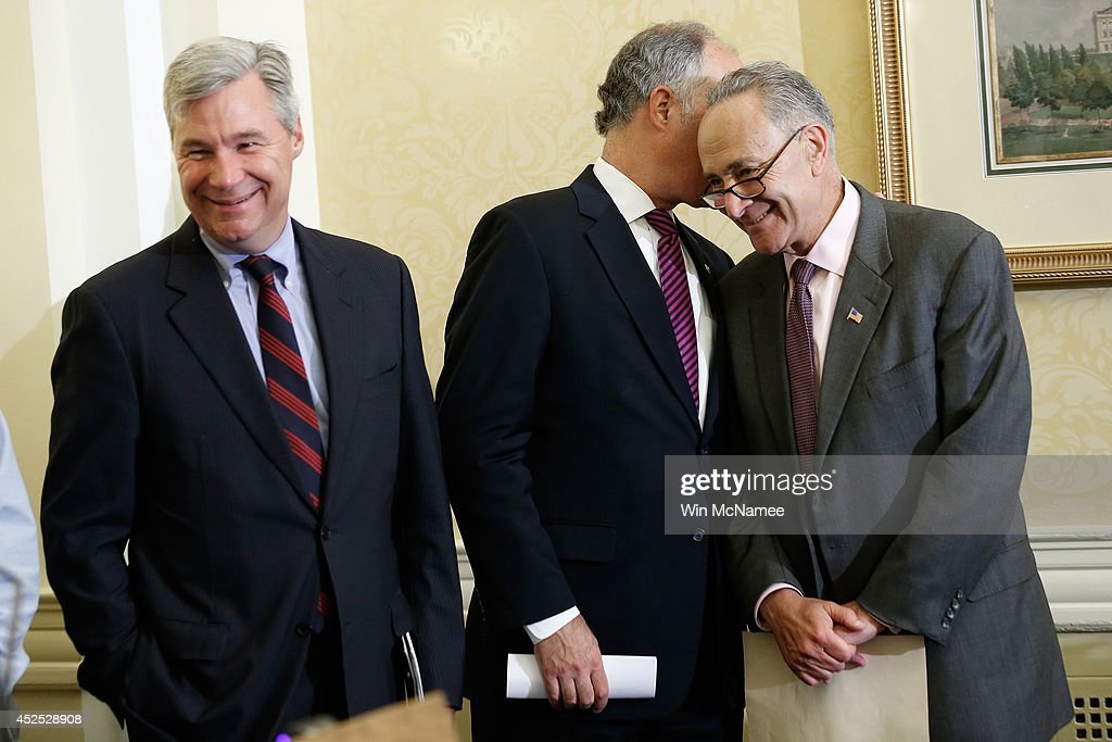 U.S. Sen. <a gi-track='captionPersonalityLinkClicked' href=/galleries/search?phrase=Sheldon+Whitehouse&family=editorial&specificpeople=599442 ng-click='$event.stopPropagation()'>Sheldon Whitehouse</a> (L) (D-RI), U.S. Sen. <a gi-track='captionPersonalityLinkClicked' href=/galleries/search?phrase=Charles+Schumer&family=editorial&specificpeople=171249 ng-click='$event.stopPropagation()'>Charles Schumer</a> (R) (D-NY) and U.S. Sen. Robert Casey (C) (D-PA) confer during a press conference about the 'Bring Jobs Home Act' at the U.S. Capitol July 22, 2014 in Washington, DC. The bill would create financial incentives for companies to return jobs to the U.S. that have been outsourced to other countries, and eliminate loopholes that financially benefit companies when they relocate jobs to other nations.